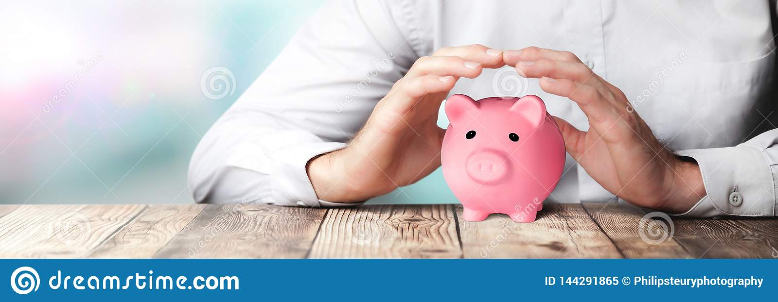 Protecting Hands Over Pink Piggy Bank - Financial Security Concept