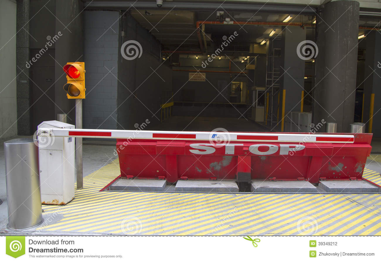 Protective Barrier At The Parking Garage With Stop Sign And Traffic
