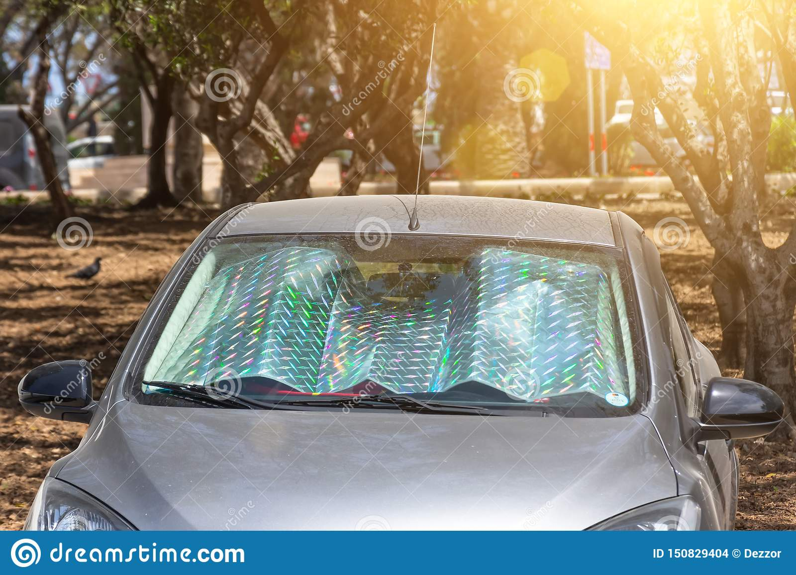 Protective reflective surface under the windshield of the passenger car parked on a hot day, heated by the sun`s rays inside the