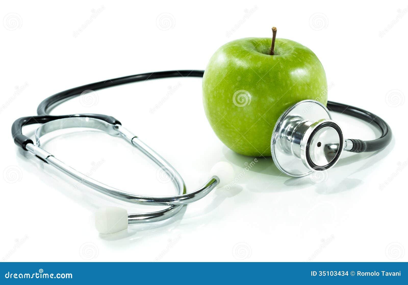 Proteja su salud con la nutrición sana. Estetoscopio, manzana