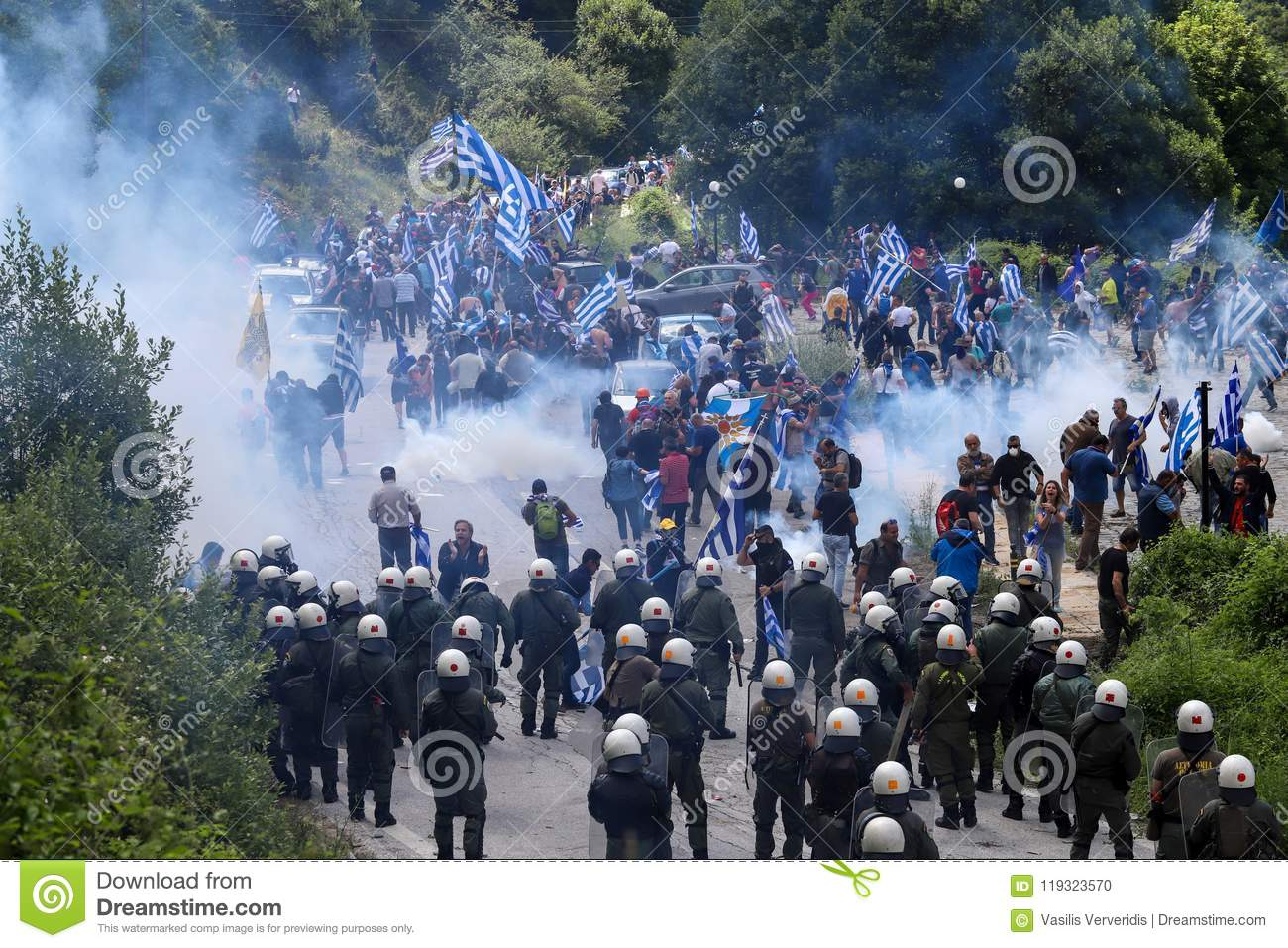 Protestors Holding Greek Flags Clash With Riot Police During