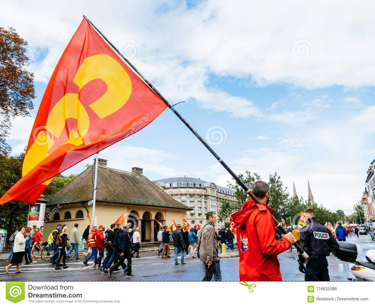 Protests in France against Macron Reforms man with SGT flag
