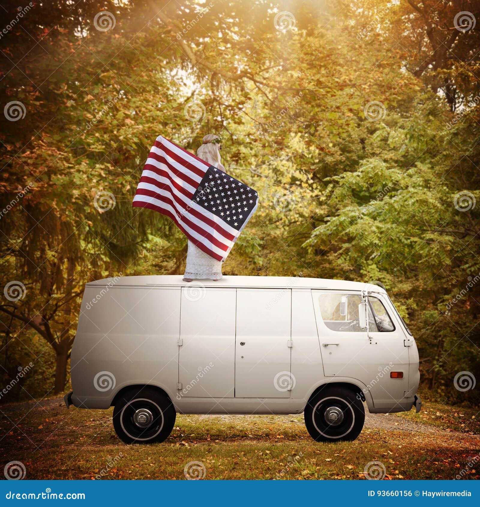 Proud American Woman Holding Flag on Vintage Van