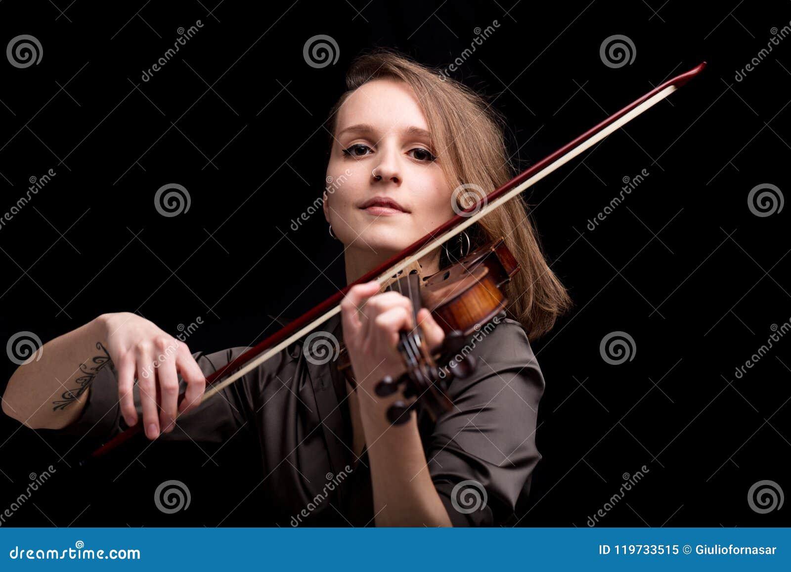 Proud baroque violinist playing folk music