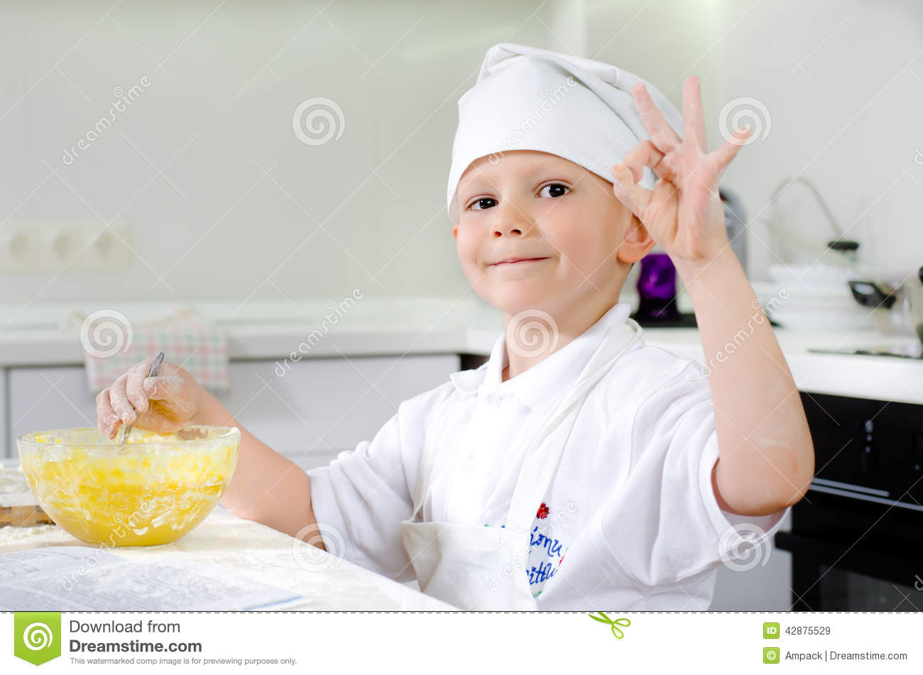 proud little boy baking in the kitchen stock photo image. Black Bedroom Furniture Sets. Home Design Ideas