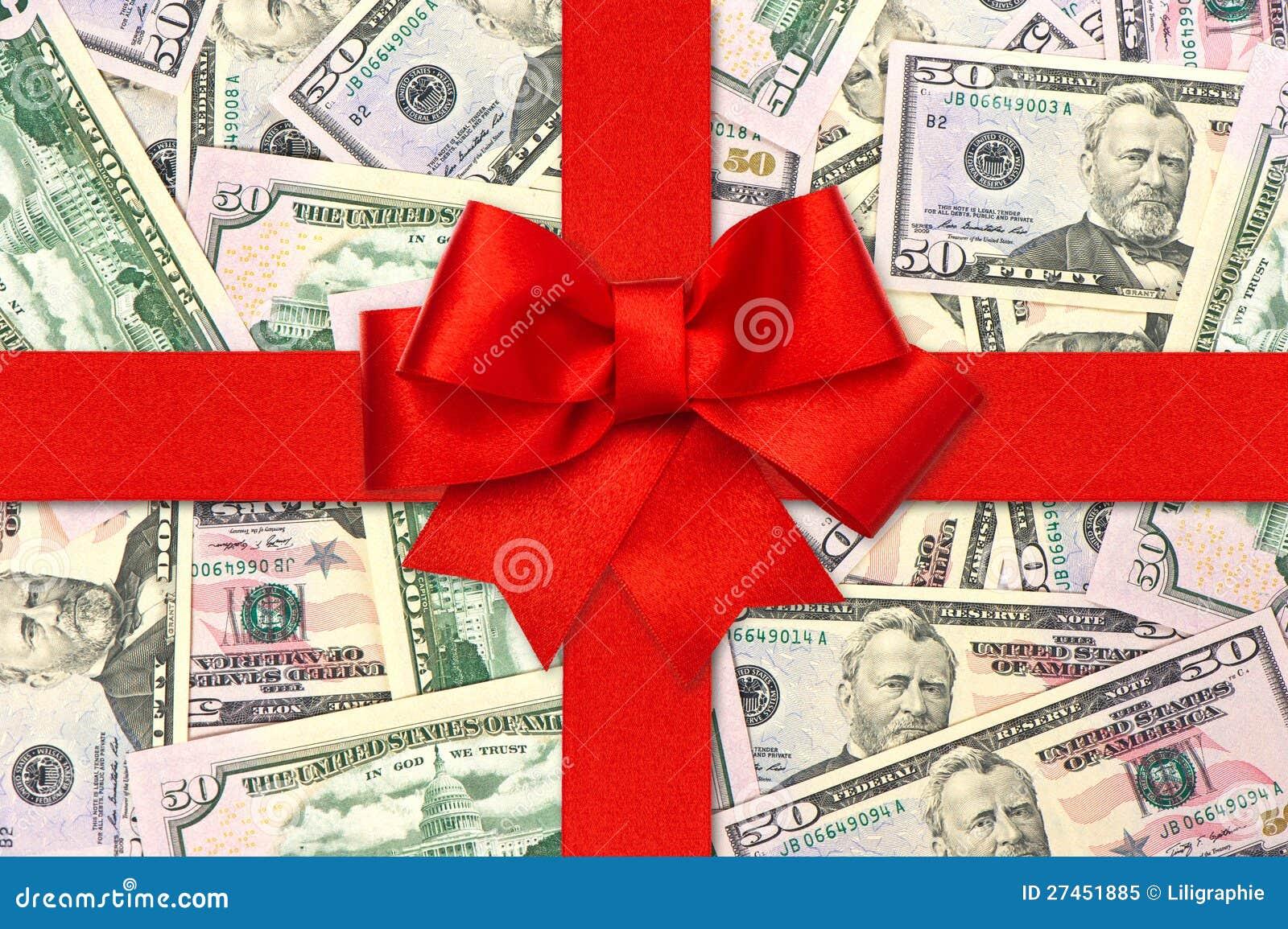 Proue rouge de bande de cadeau au-dessus des dollars américains