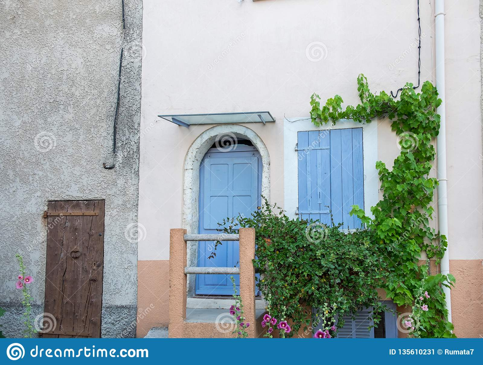 Provence Style Blue Wooden Doors And Window Shutters Stock