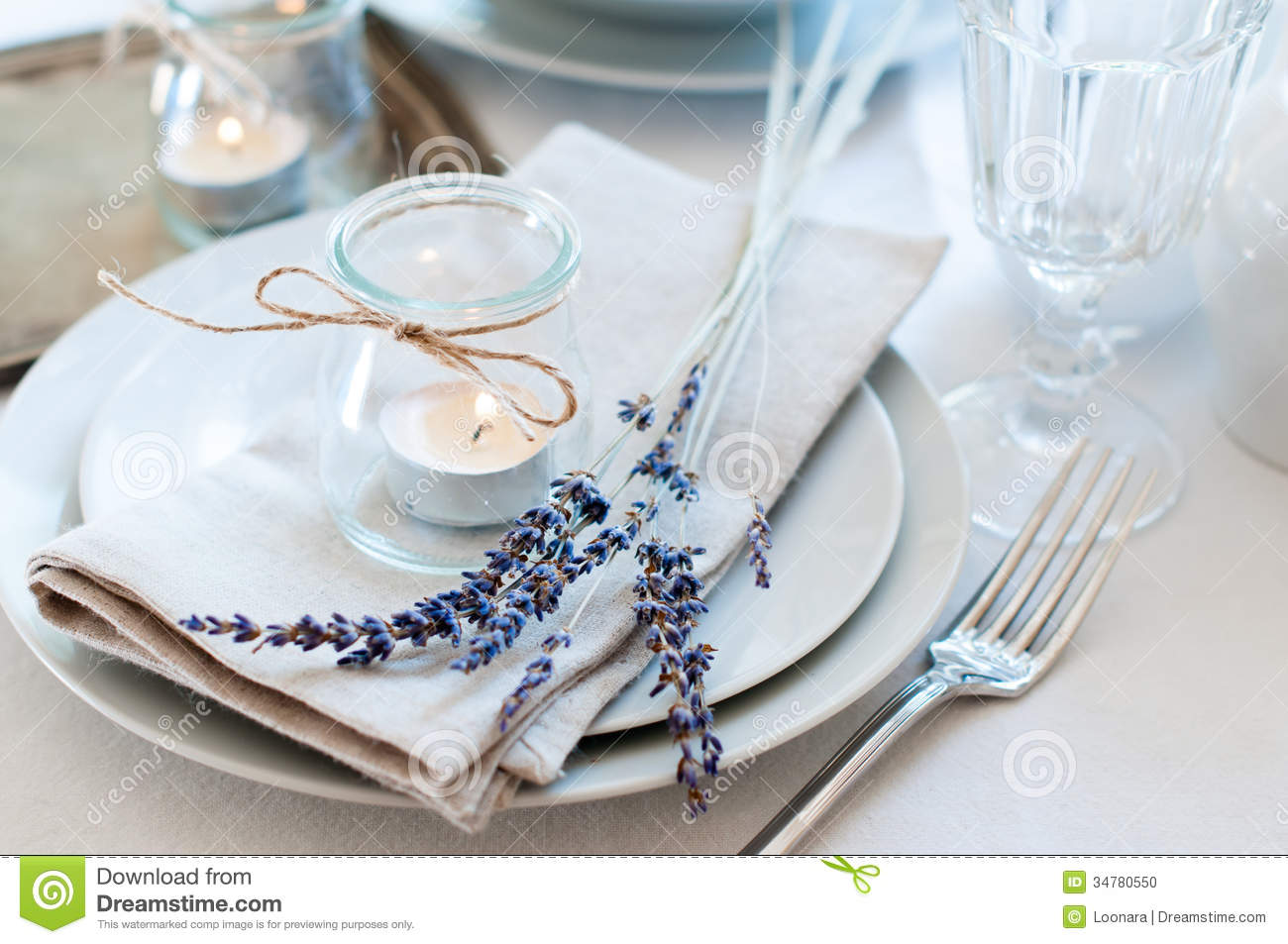 Dining table setting at Provence style, with candles, lavender ...