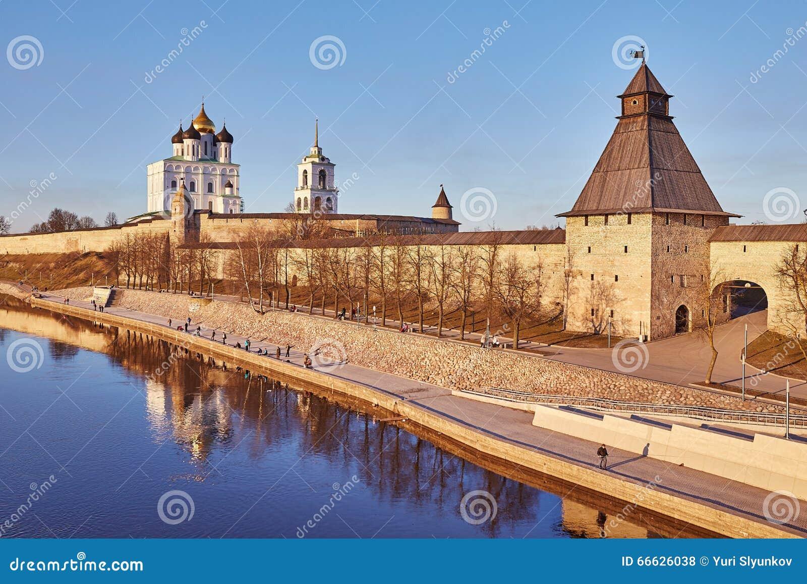 Pskov. Spring. Fishermen on river quay Great. Fortification