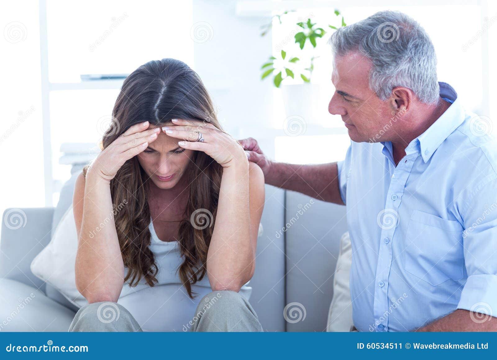 Psychiatrist advising pregenat woman in clinic