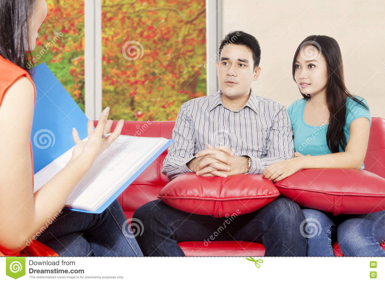 Psychiatrist giving motivation for young couple