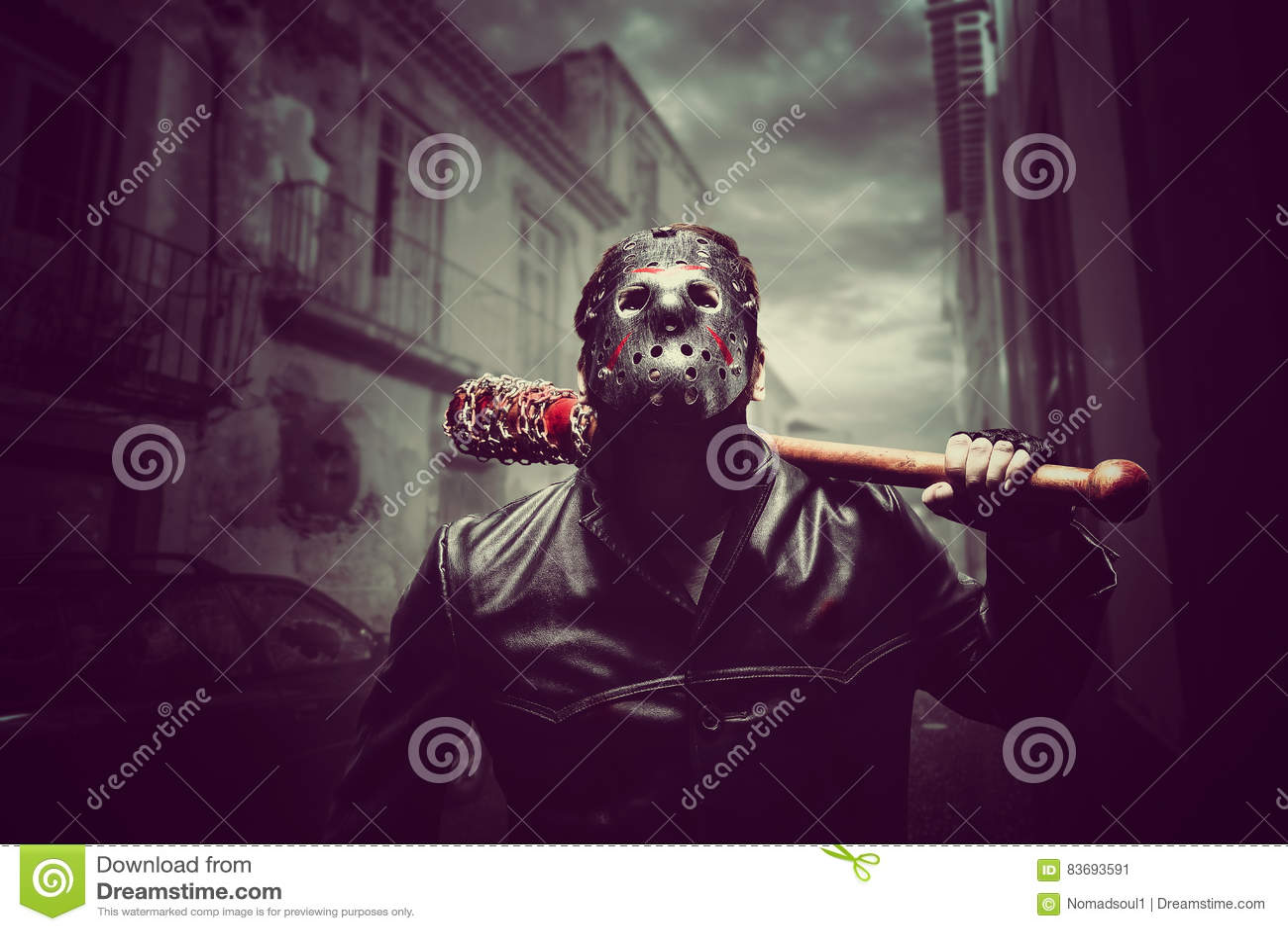 Psycho man in hockey mask with bloody baseball bat