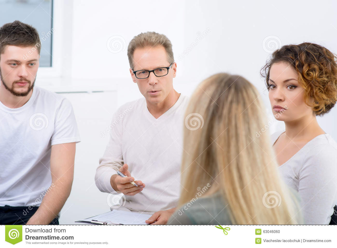 Download Psychologist Working With Group Of People Stock Photo