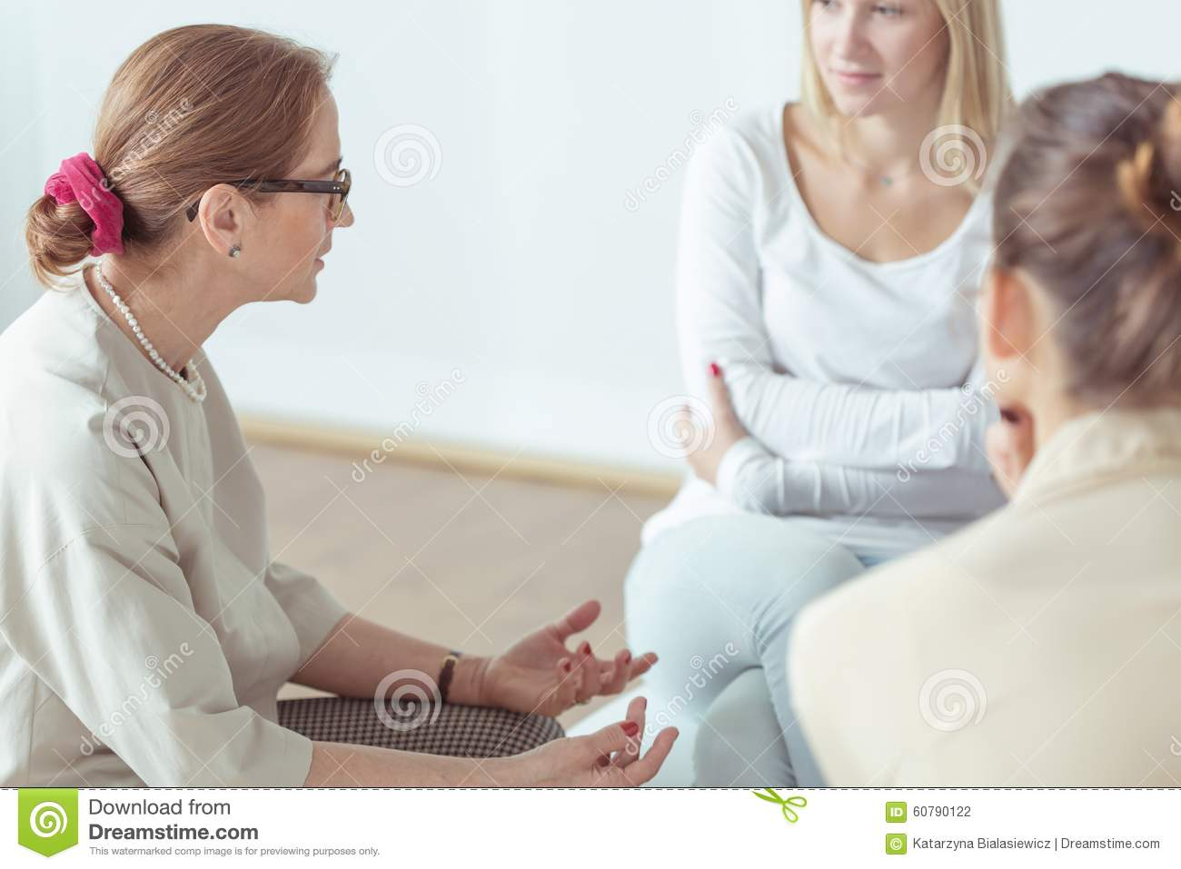 Psychotherapist talking with support group