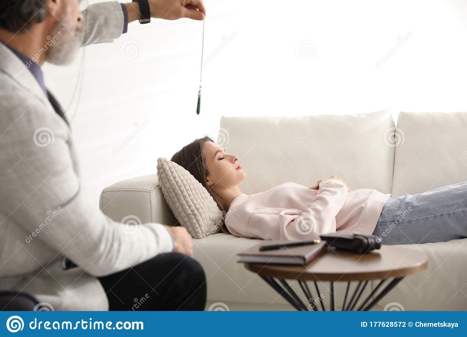 Psychotherapist Using Pendulum During Hypnotherapy Session ...