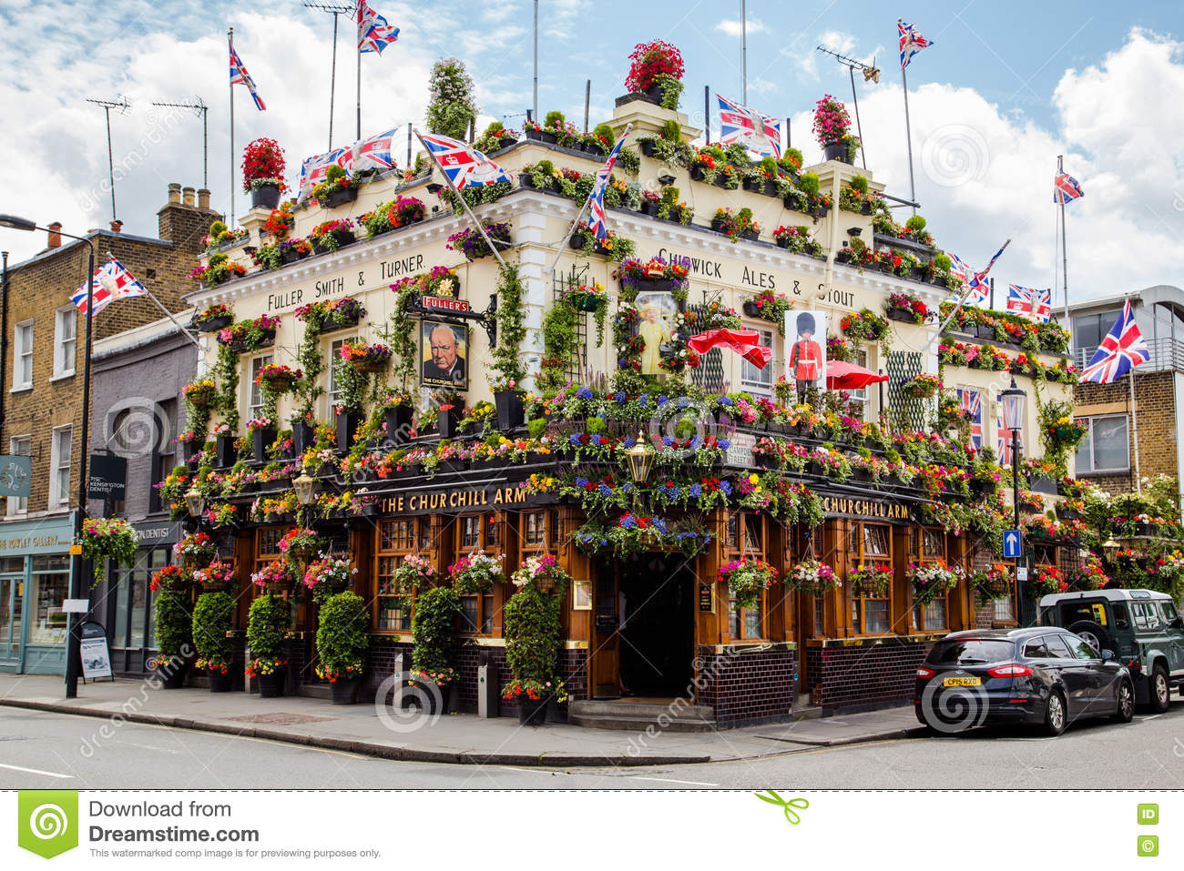pub covered in flowers in london editorial stock photo image 74388868. Black Bedroom Furniture Sets. Home Design Ideas