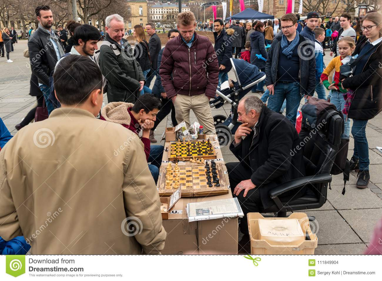 Public Chess Game By Amateurs On The Central Historical Street Of Koenigstrasse King Street