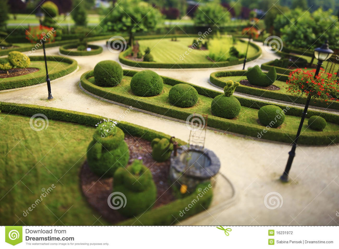 Download Public Garden With Cut Bushes Stock Photo