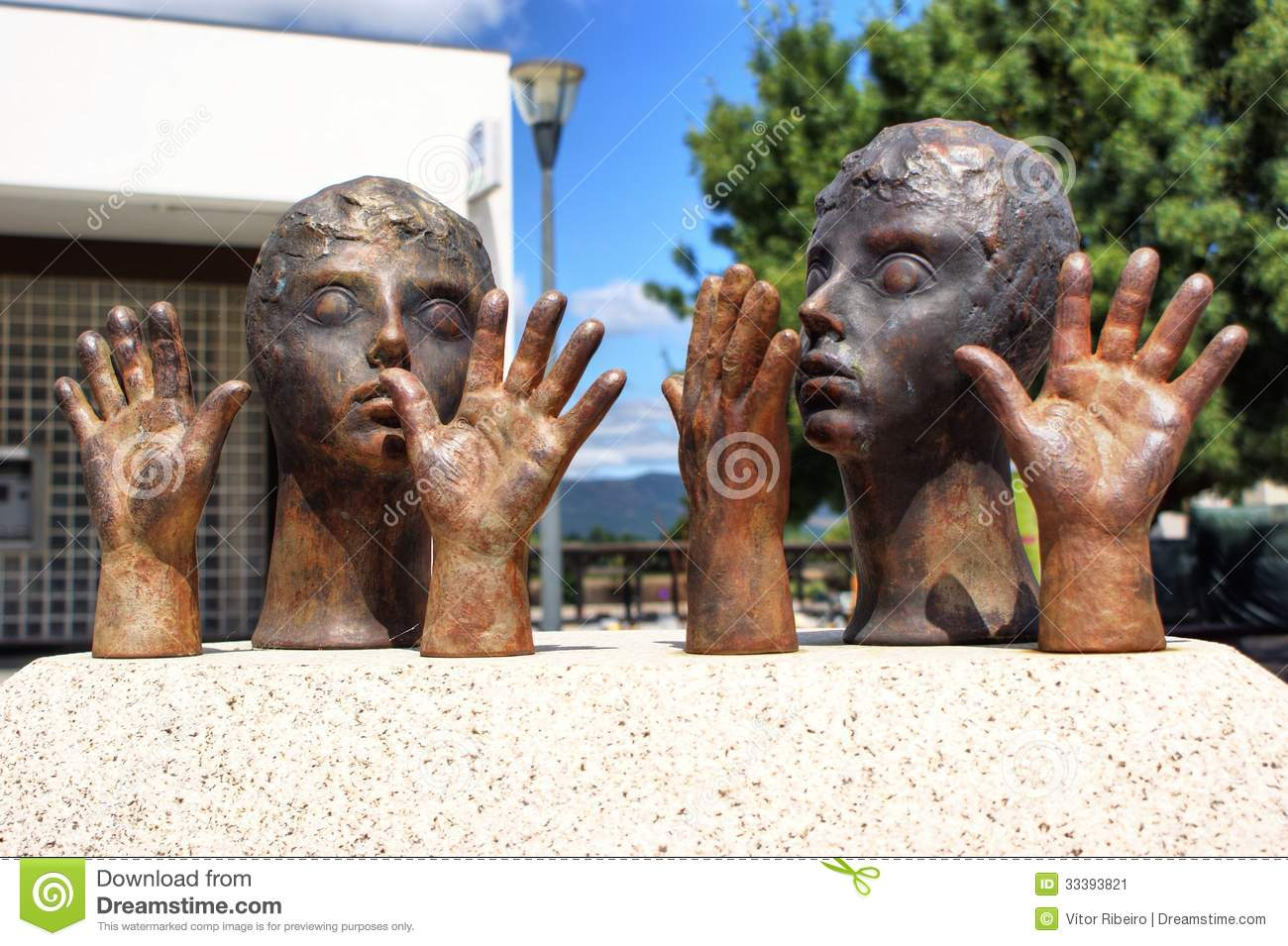 Public sculpture of hands and heads