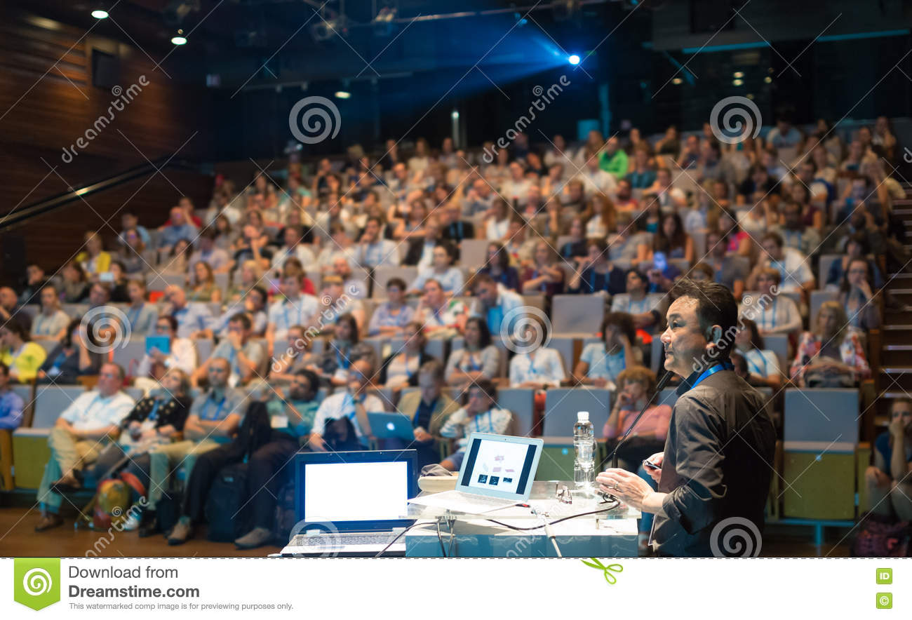 public speaker giving talk at business event  stock photo