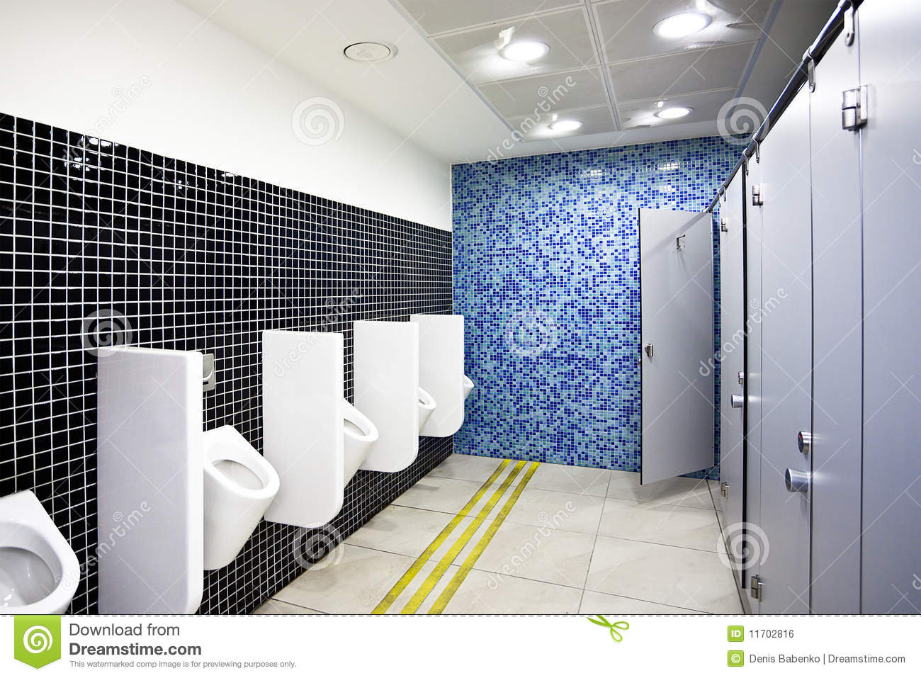 Public Toilet With Cubicles And Urinals Royalty Free Stock