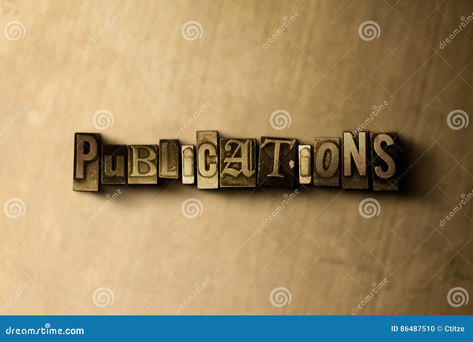 PUBLIKATIONER - närbild av det typsatta ordet för grungy tappning på metallbakgrunden