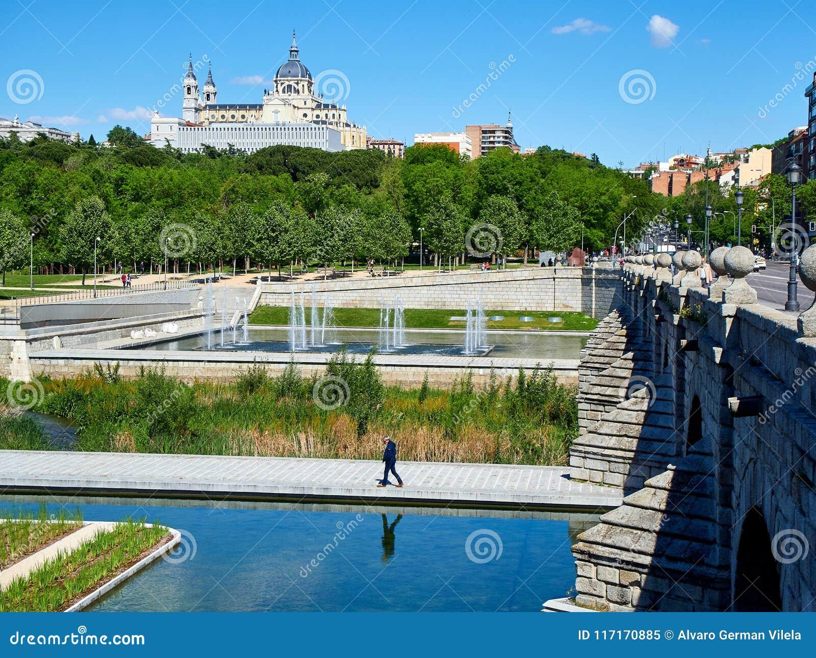 Puente de Segovia bridge crossing the gardens of Madrid Rio.