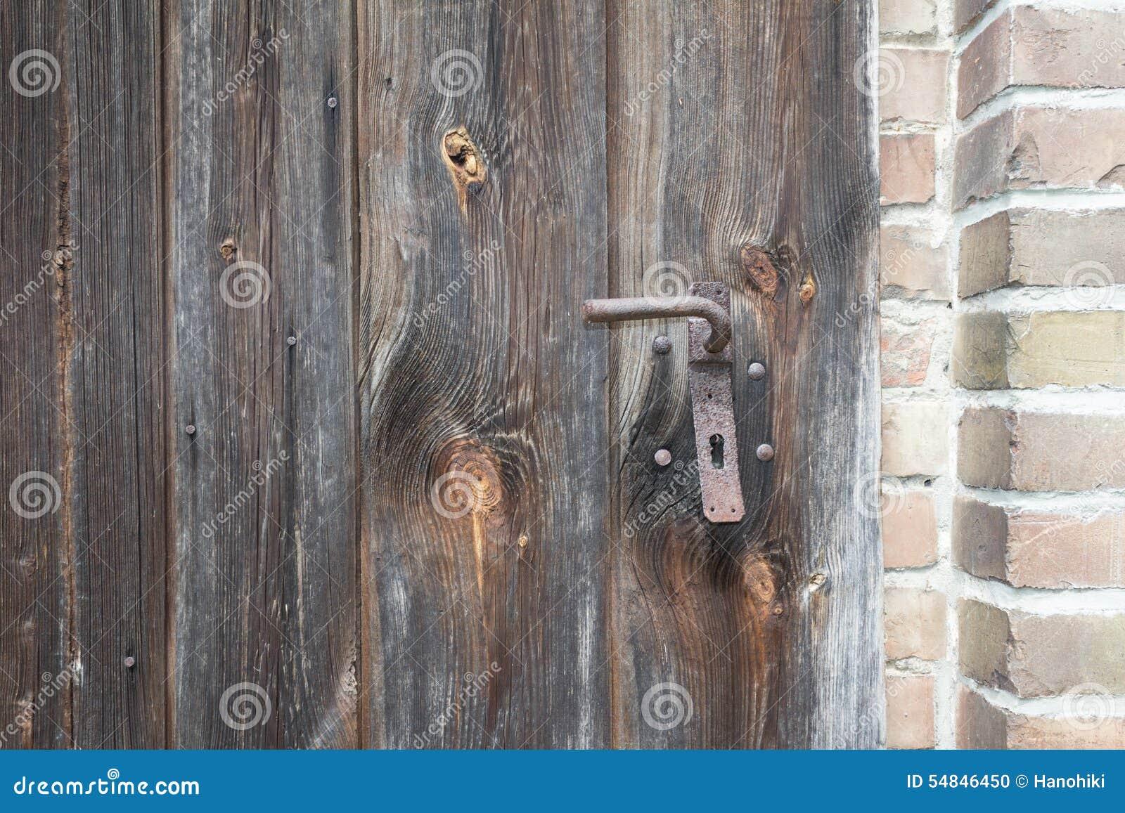 Puerta de madera vieja fondo de madera de la textura for Puerta vieja madera