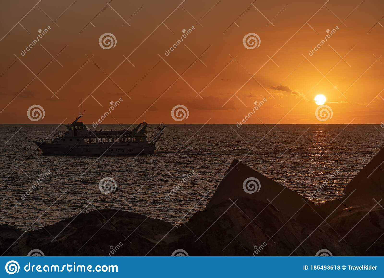 Amazing Sunset Rocks And Stones At Foreground And Glass Bottom Boat Passing Stock Image Image Of Dusk Nature 185493613