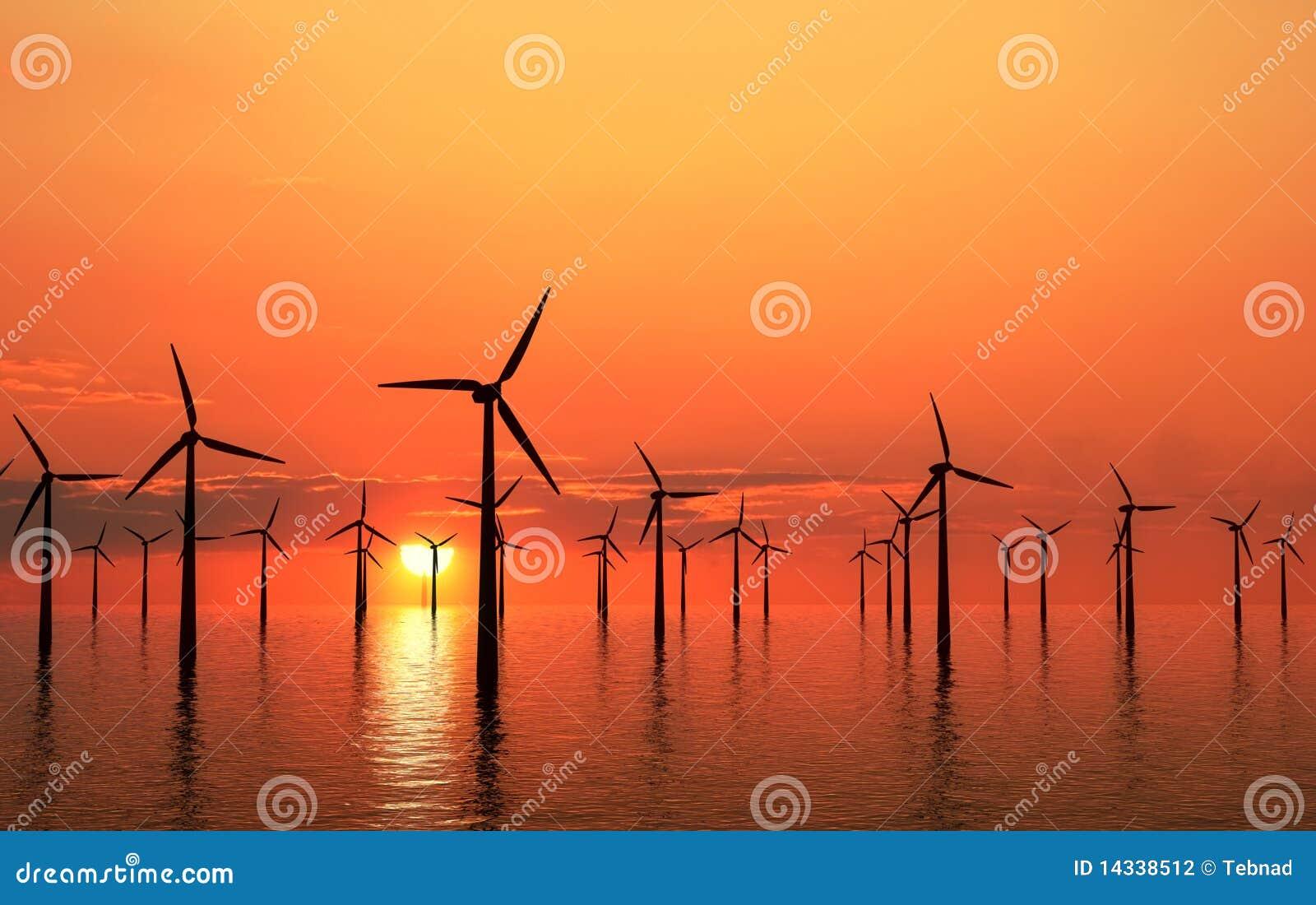Puesta del sol costera de las turbinas de viento