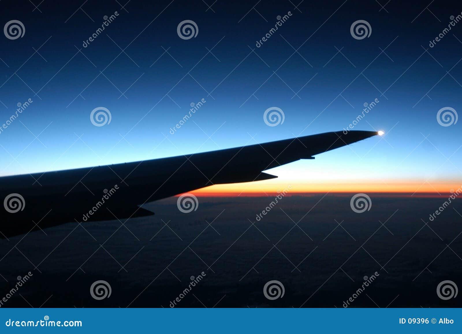 Puesta del sol del aeroplano