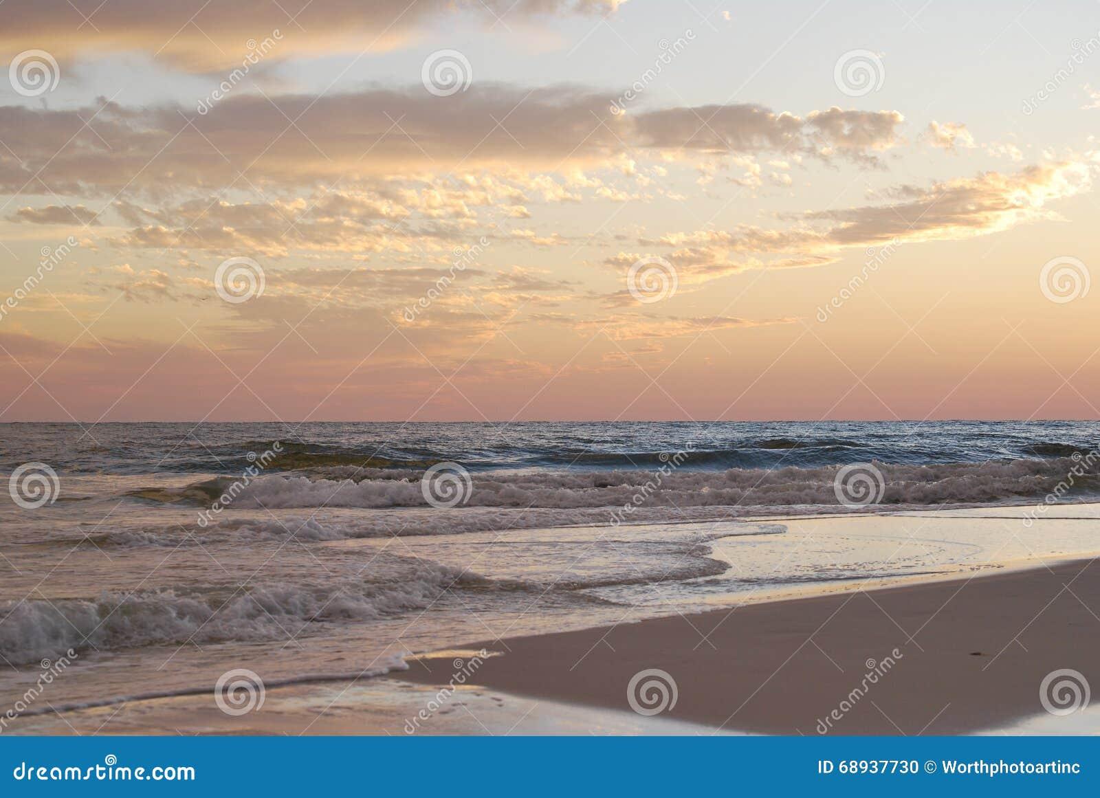 Puesta del sol la Florida Pan Handle de la playa