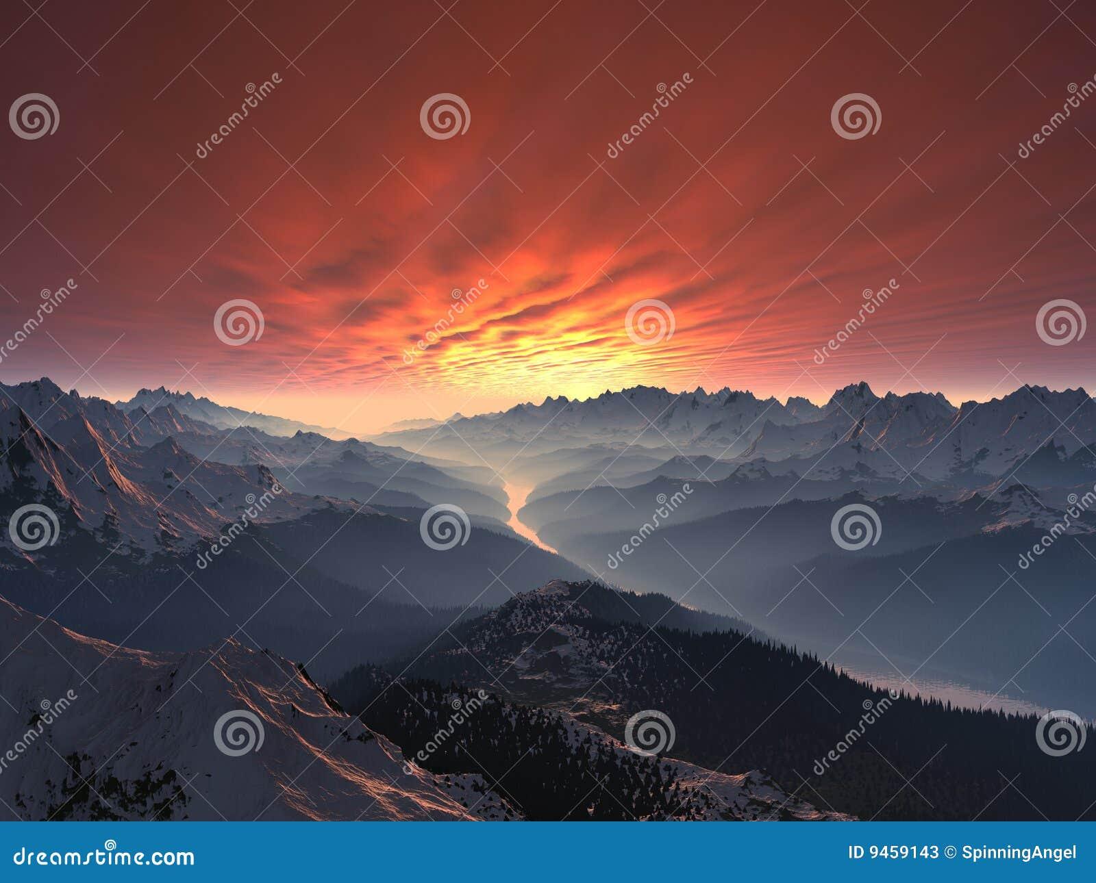 Puesta del sol nevada del valle de la montaña