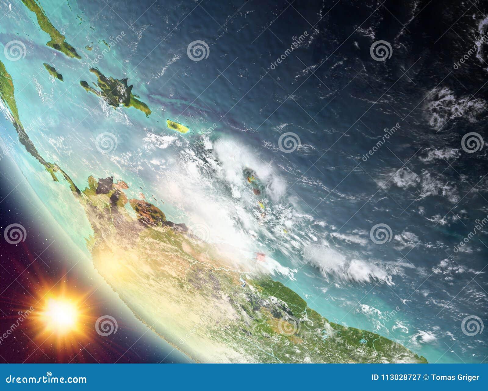 Puesta del sol sobre el Caribe en la tierra