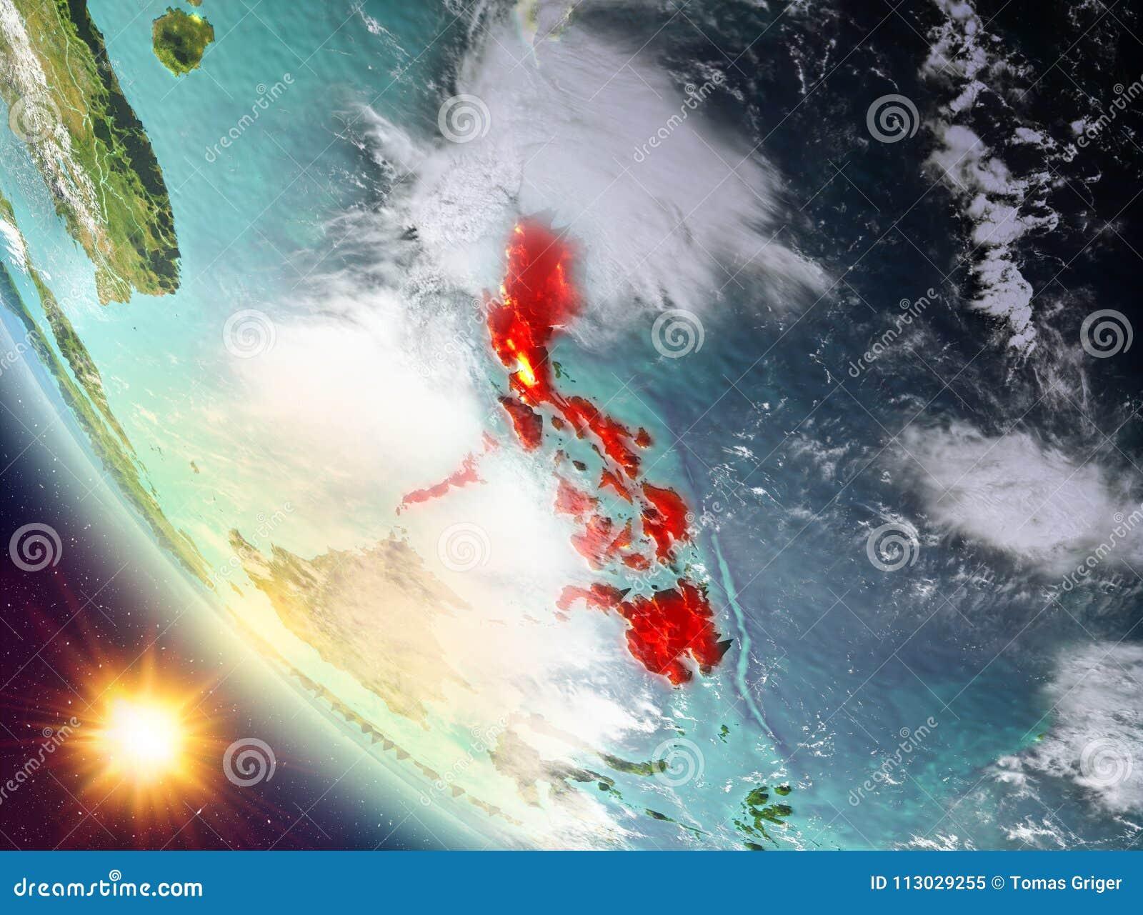 Puesta del sol sobre Filipinas en la tierra
