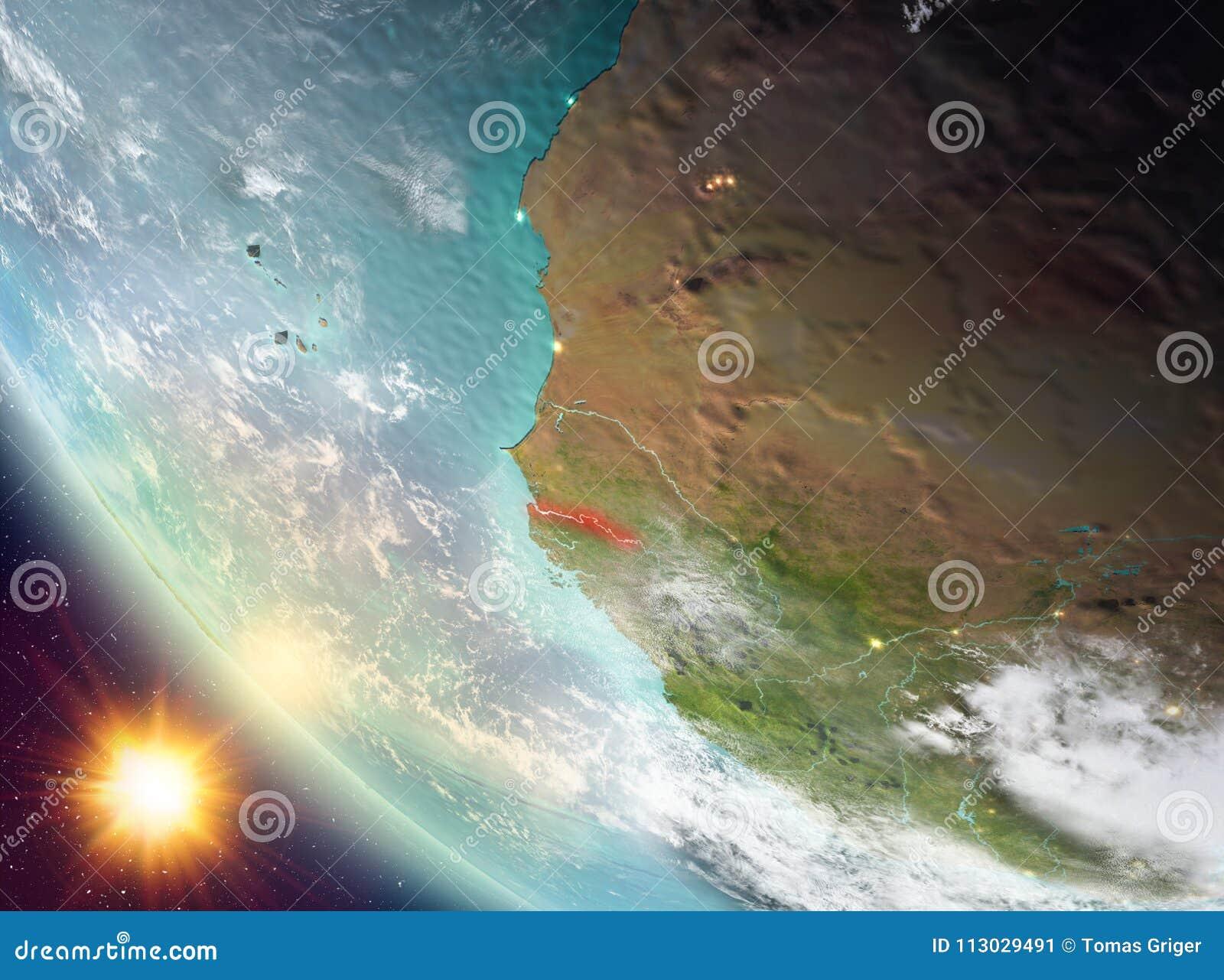 Puesta del sol sobre Gambia en la tierra