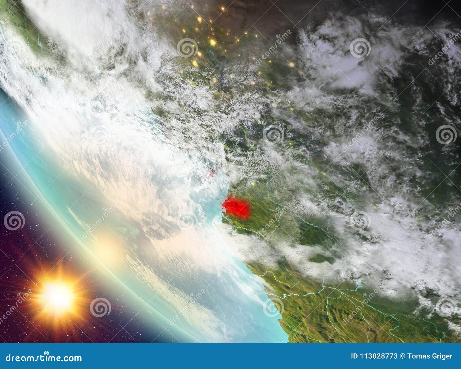 Puesta del sol sobre Guinea Ecuatorial en la tierra