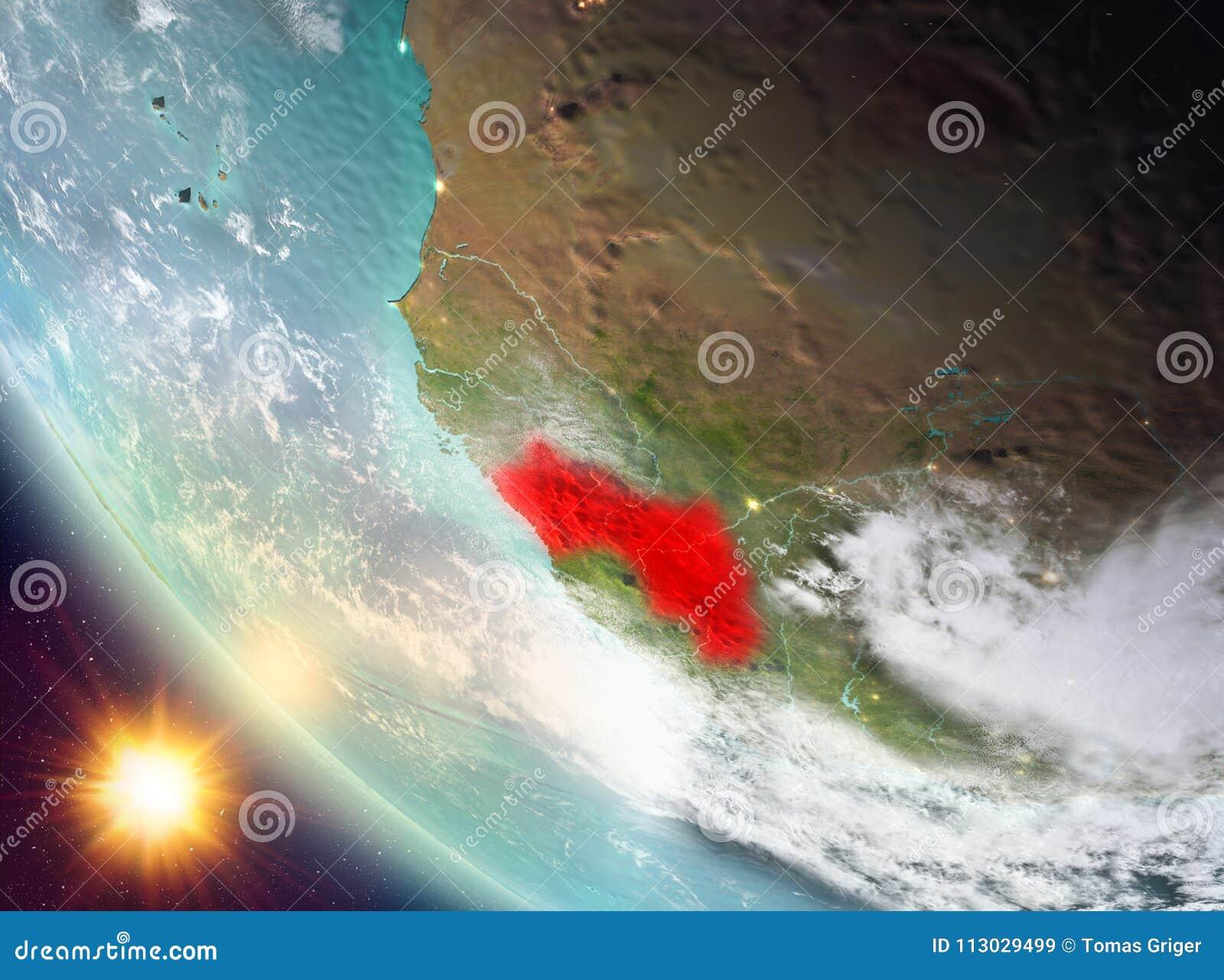 Puesta del sol sobre Guinea en la tierra