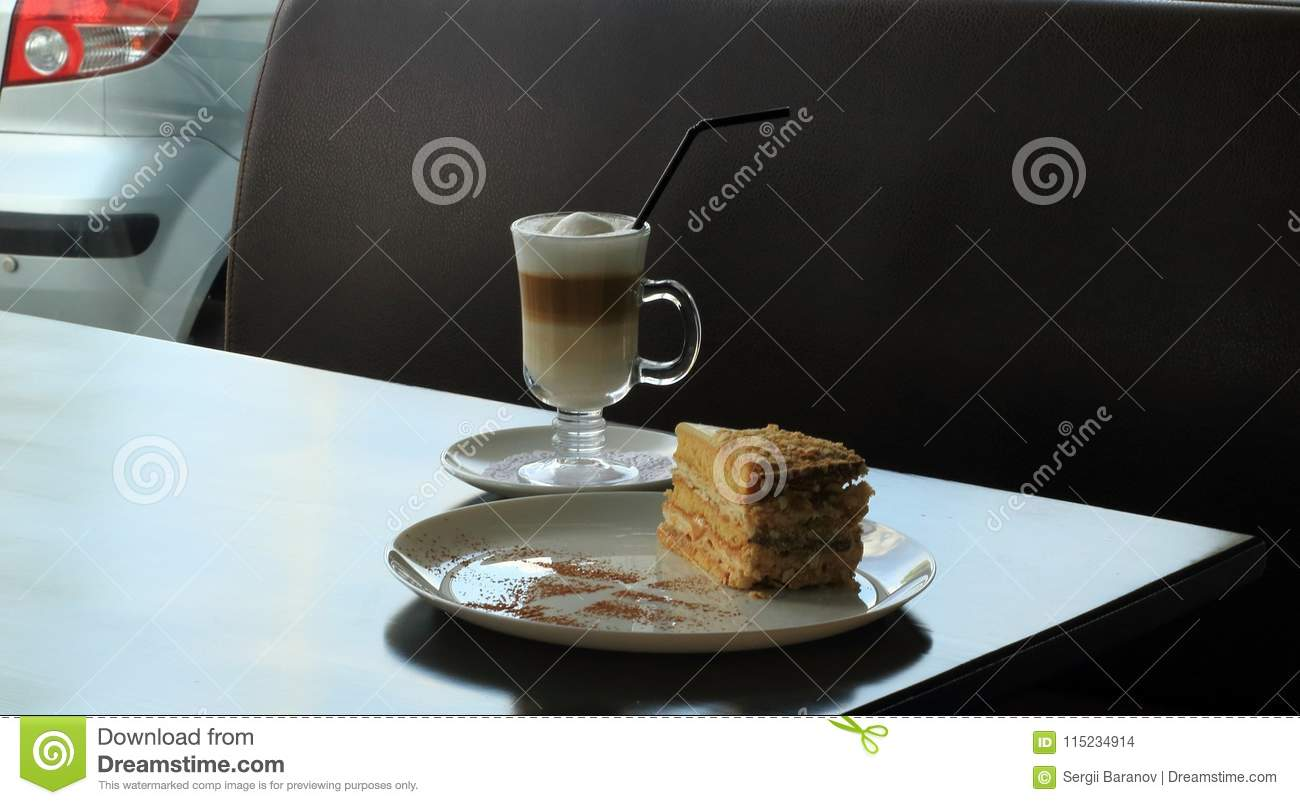 Puff Pastry Cake And Cream Coffee On Table At Gas Station Snack Bar