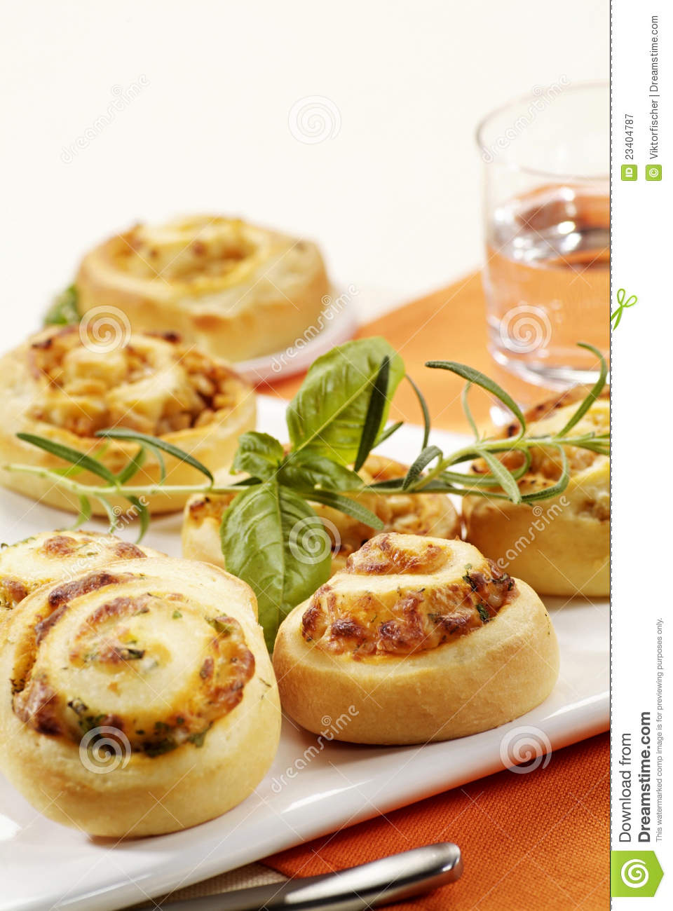 Puff pastry swirls with herb filling