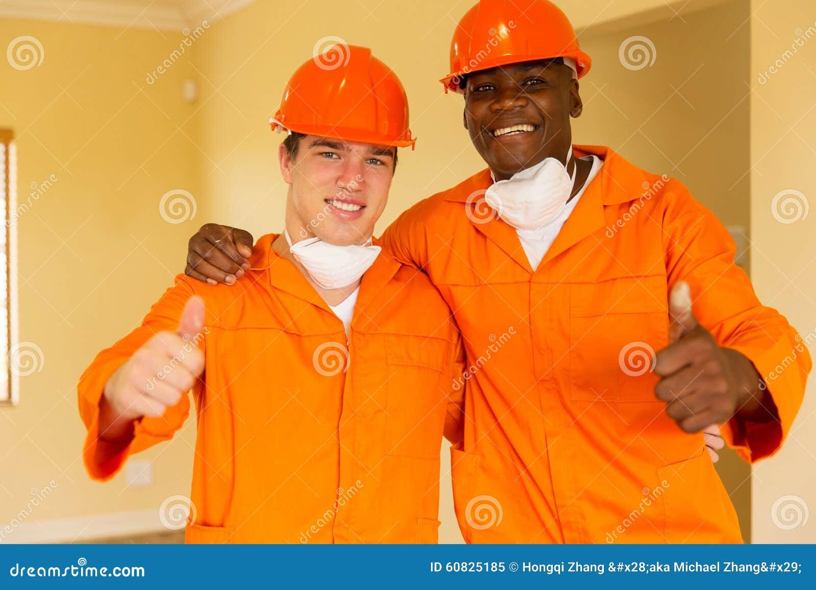Pulgares de los trabajadores para arriba