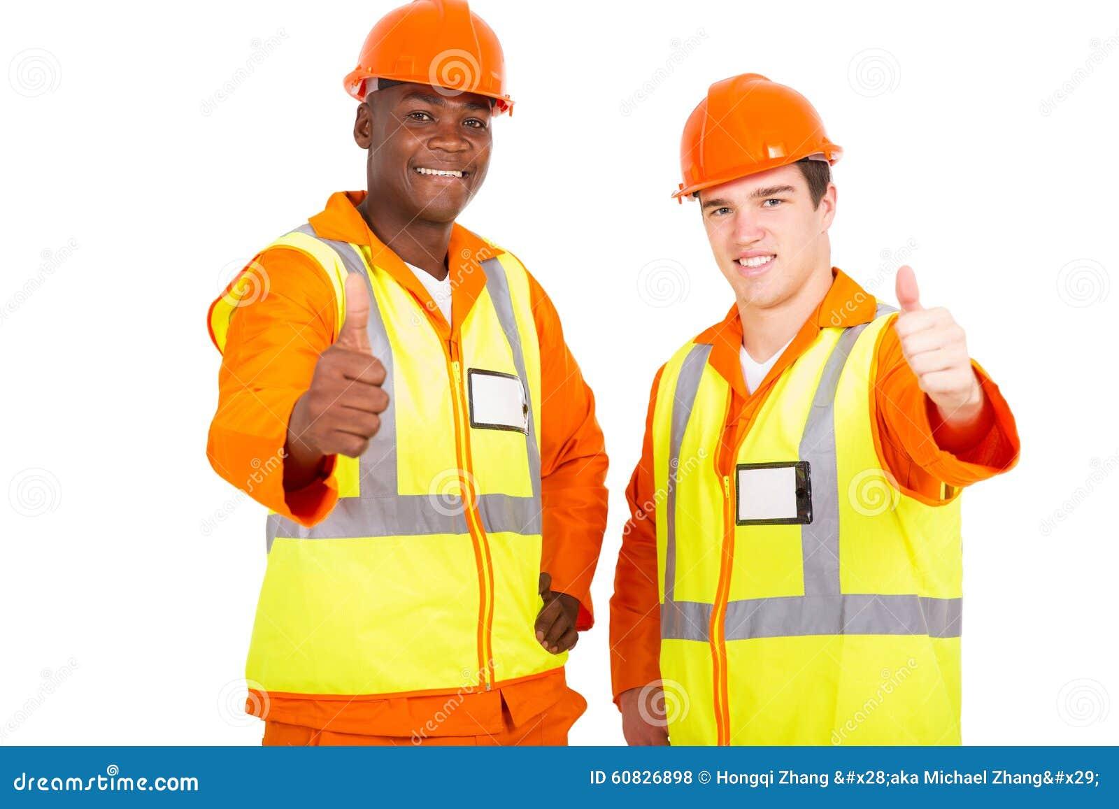 Pulgares jovenes de los ingenieros para arriba