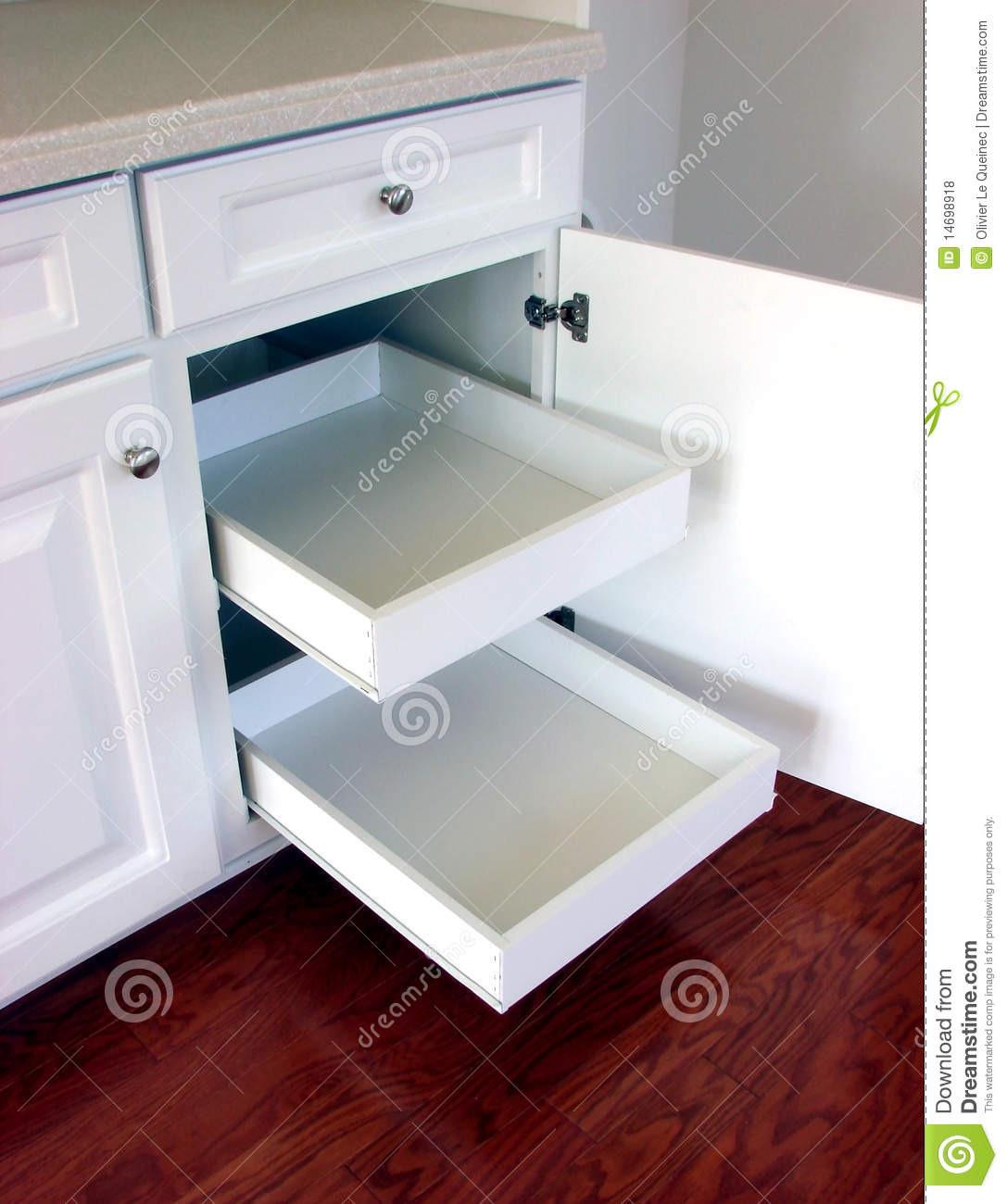 Pull out kitchen drawers shelves in a modern house royalty free stock