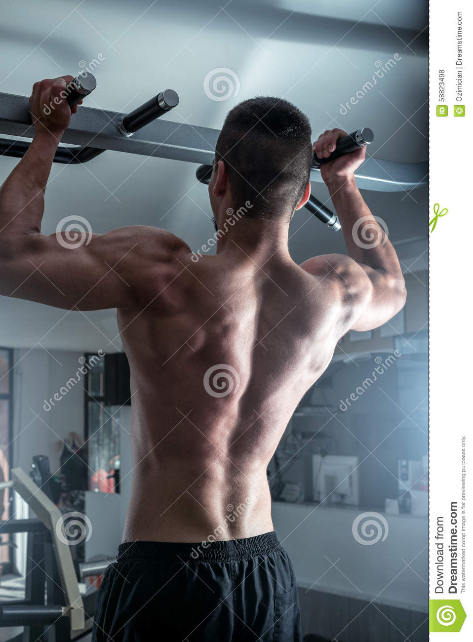 pull ups in gym stock photo. image of definition, athlete - 58823498