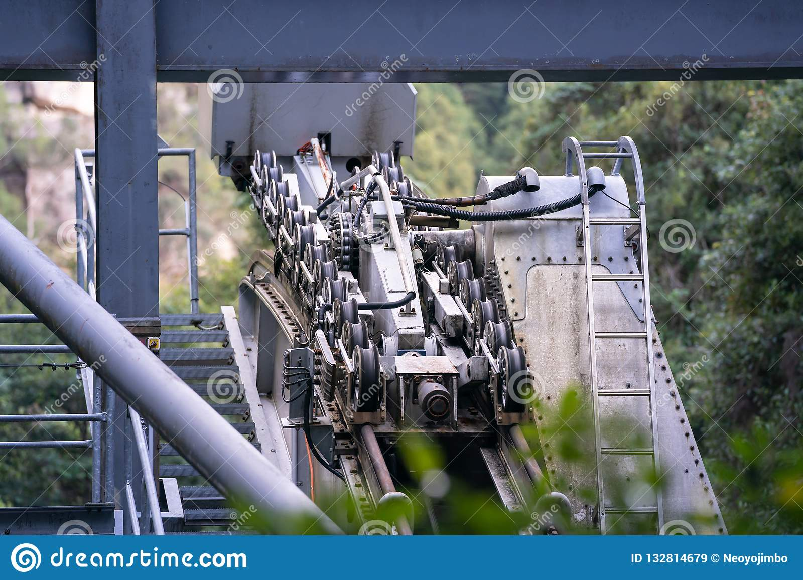 The pulley engine gears of ropeway on a cabins or funicular railway.