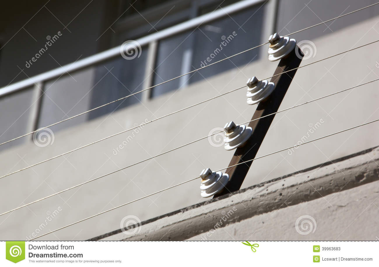 pulleys supporting electric fence of residential building