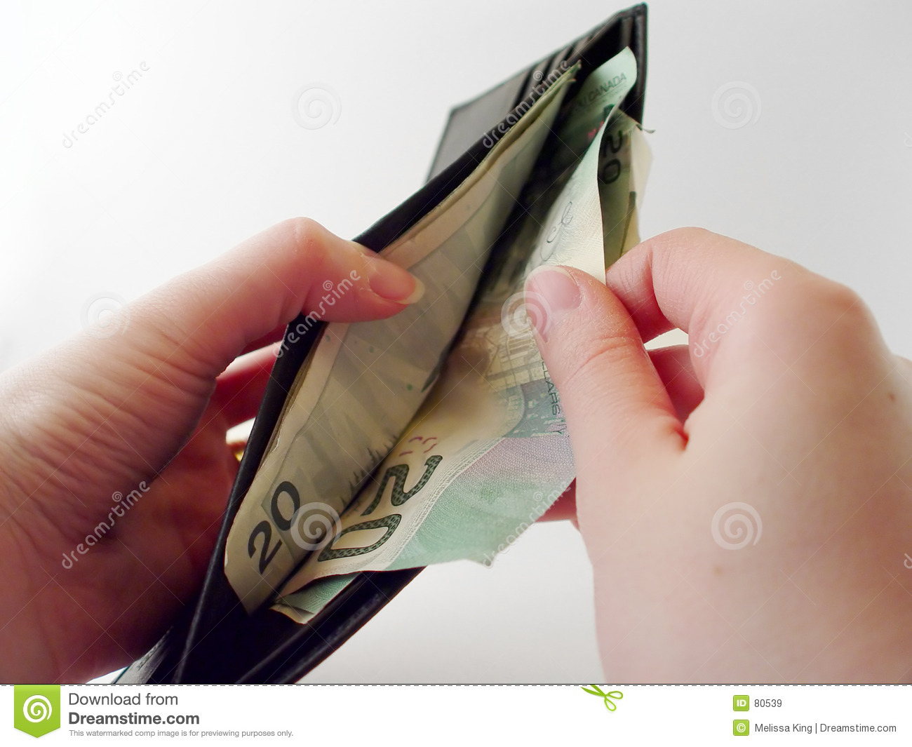 Pulling Money Out Of Wallet Royalty Free Stock Images