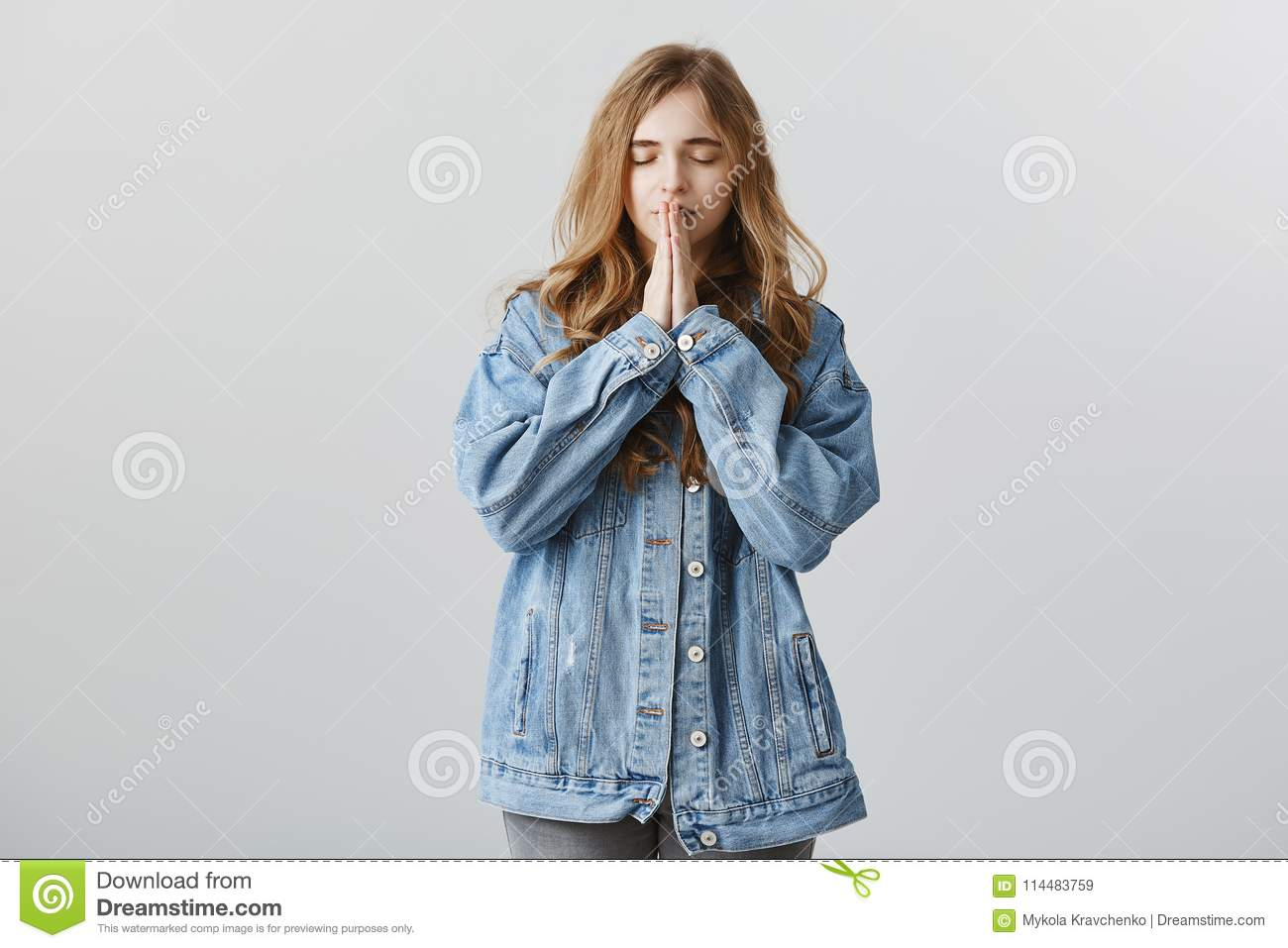 Pulling up feelings to think straight. Indoor shot of confident attractive fashion editor in stylish denim jacket