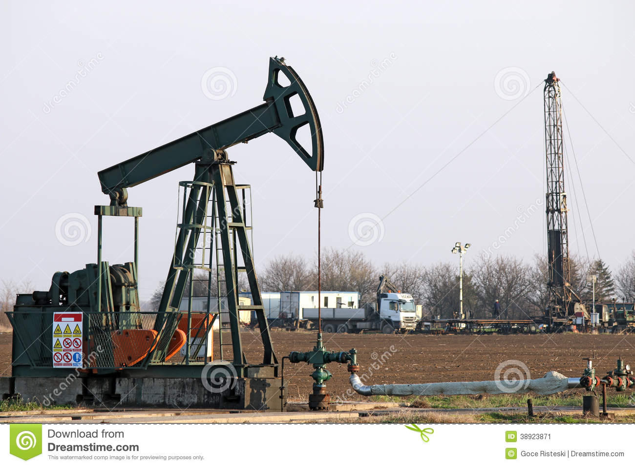 pump jack and oil drilling rig stock photo image 38923871