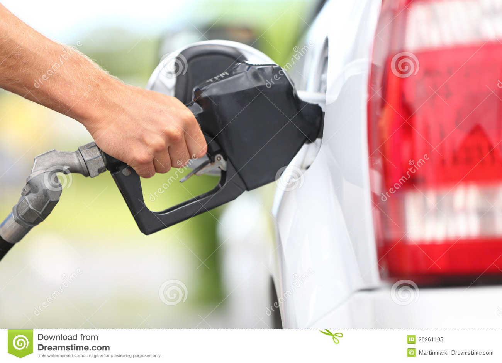 Pumping gas at gas pump